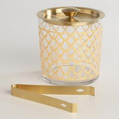 Our elegant glass ice bucket comes with a matching gold metal lid and tongs. Featuring an eye-catching gold design, it adds stylish flair and function to your bar.