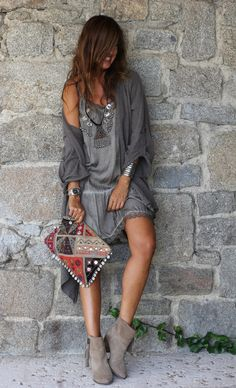 So Bohemian dress with boho chic ethnic print tribal inspired clutch, modern hippie suede fringe boots, and gypsy chunky necklace.