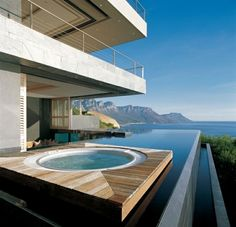 Modern house deck infinity pool built in jacuzzi holiday home Switzerland