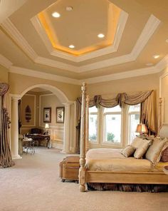 Love the layered ceiling, classy bed posts & details, warm neutral colors, and archways.