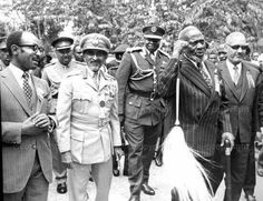 WHAT A NICE AND MEMORABLE PICTURE OF  MZEE JOMO KENYATTA WITH EMPEROR HAILE SELASSIE AKA RAS TAFARI WITH IDI AMIN OF UGANDA IN THE BACKGROUND. UNFORTUNATELY, THE PICTURE IS UNDATED.