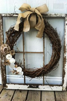 Old window frame from junk yard, hobby lobby wreath.. Hot glue and burlap ! Apartment decoration for Amy Beth !