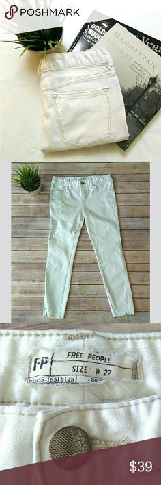 Free People ankle cropped white skinny jeans Free People white skinny jeans.  The color is an off white.    They cropped / ankle length and have some little slits on the leg opening.  The denim has a herringbone pattern texture which is very subtle and only noticeable when you get up close.   Waist: 15 inches laying flat Rise: 8.5 inches Inseam: 26 inches Free People Jeans Ankle & Cropped