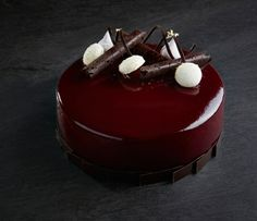 Dark chocolate mousse, coconut daquise, coconut crème, sour cherry compote and white chocolate toasted coconut crunch entremet