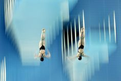 Guangzhou, China: Eunbi Cho and Seung Eun Yun of DPR Korea compete in the Women's Synchronised 10-metre Platform at Aoti Aquatics Centre
