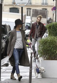 Once around the block: Zoe Saldana and her husband Marco Perego were pictured walking their dog Mugsy in Paris on Monday
