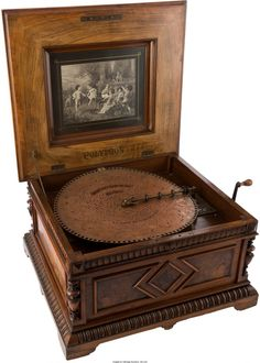 """43314: Polyphon 15 1/2"""" Style 45 Disc Music Box in Orna : Lot 43314"""