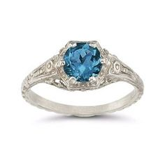 $475 - 18K london blue topaz vintage style ring. I am considering having a topaz put into an antique Edwardian style ring i have.
