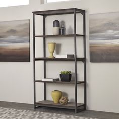 The Barnside Metro 5-Tier Shelf by Home Styles exhibits an alluring industrialized design that displays mixed media materials. The look is achieved by employing a wire brush technique with a driftwood finish.