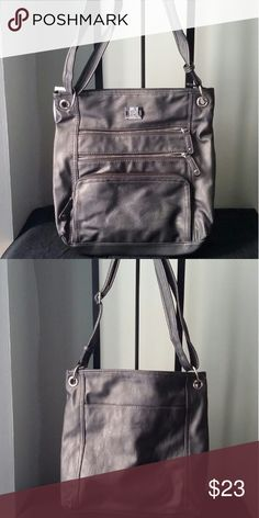 """Style & Co Nina Crossbody Faux leather Adjustable crossbody strap with 20"""" drop Zip closure Exterior features silver-tone hardware, front logo plaque, removable logo hangtag, 3 front zip pockets and 1 back slip pocket Interior features 1 zip pocket and 2 slip pockets Style & Co Bags Crossbody Bags"""