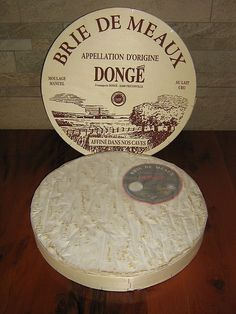 (Post) This is a raw, soft unpasteurized cow's milk cheese covered with a bloomy rind, a result of inoculation with Penicillium Candidum molds. As the cheese ages, the rind develops red or brown patches. When nearly half of the straw colored pate is ripe and soft, it indicates Brie de Meaux is ready for consumption.  Brie has a milk and rich taste underlined by sweet and buttery flavors of mushrooms or truffles and almonds.
