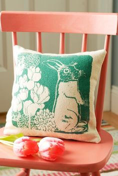 Aw, sweet little bunny pillow.  Natural bark cloth canvas that's printed with her original artwork.  By erinflett on Etsy, $35.
