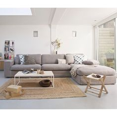 L-Shaped sectional with sisal area rug living area