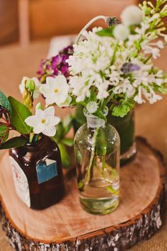 rustic tree slab and vintage bottles for centerpiece ideas