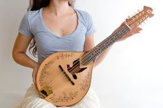 Beautiful!!! Now I just need to learn how to play. Dove sound hole Mandolin by celentanowoodworks on Etsy, $1200.00