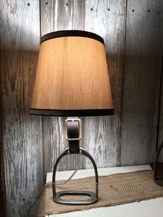 Each lamp is hand crafted here in our shop starting with a vintage iron that has a patina all its own. Perfect as a desk or bedside lamp, let this stirrup tell its unique equestrian story as it illumi