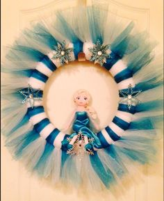 Frozen inspired Elsa wreath.  Made with white and turquoise glitter tulle.