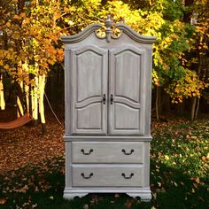 """Gorgeous Painted TV Armoire.  Dimensions: W40"""" x H81.5"""" x D19"""" Antique white, Millstone distressed. Milk paint, General Finishes"""