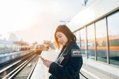 View top-quality stock photos of Young Woman Using Smartphone On The Train Platform. Find premium, high-resolution stock photography at Getty Images. Train Platform, Train Station, Still Image, Young Women, Royalty Free Images, Smartphone, Photoshoot, Stock Photos, Lifestyle