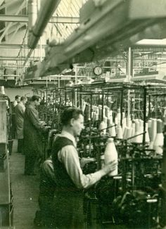 Knitting machine mechanics making sure everything runs smoothly at the Pantherella factory in the 1940s