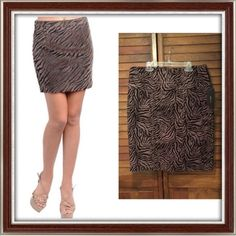 NWT! Taupe Zebra Print Pencil Skirt NWT! Chic taupe skirt with zebra print design, pencil style, velvet-like material on stripes, slit in back, zipper in back, and high waist. Pair with a black or brown solid top and cardigan, high or low boots for a super stylish and chic outfit. Great for work! Excellent never worn condition!  ✅ASK QUESTIONS ✅Bundle ✅Offers ❌NO Trades ❌NO Off-site Transactions Robert Louis Skirts Pencil