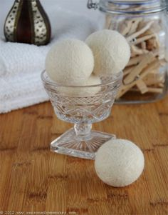 You will never have to buy over-scented dryer sheets or fabric softener again:  DIY dryer balls