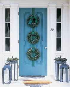 Beautiful peacock blue triple wreath front door decor for Christmas with lanterns