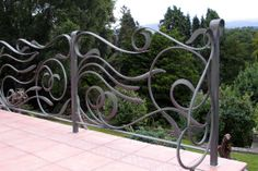 wroght iron modern rails | the design of the support posts complement the railings