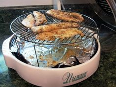Wendy R. made mouth-watering tilapia using her NuWave Oven Pro in just a few minutes! Plus, as you can see, by lining the liner pan with tin foil, cleanup was a snap!  After marinating the fish in lemon juice and Old Bay seasoning, Wendy cooked the tilapia for 5 minutes per side on Power Level HI on the 4-inch rack. After garnishing with some parsley, dinner was served!