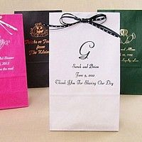Personalized paper party bags available in 9 color options and with your choice of design, monogram, and text options