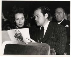 Orson Welles and Dolores del Río are snapped by a news photographer while attending a concert at the Los Angeles Shrine Auditorium in Dec. 1941.