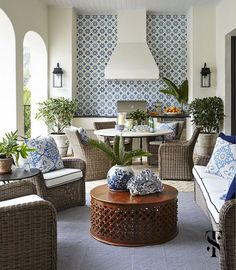 Naples Florida lanai with blue and white tile backsplash | interior architecture and interior design by Summer Thornton www.summerthorntondesign.com
