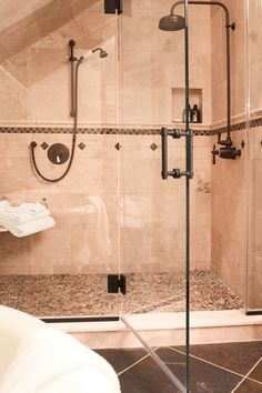 Frameless shower glass i like the half privacy wall for for Oil rubbed bronze bathroom ideas