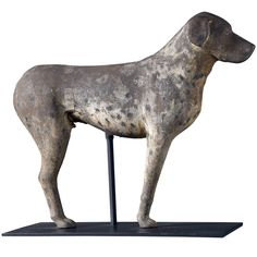 Cast Iron Standing Dog  USA  19th century  Iron with traces original polychrome.  Half mold of standing bird dog.  Custom metal base.