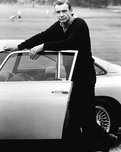 Sean Connery as James Bond in Goldfinger with the Aston Martin DB5
