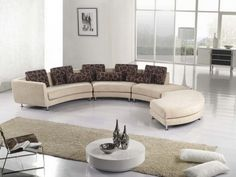 Interior. Modern Curved Ivory Leather Sectional Sofa With Dark Tone Cushions Also Small Pillowcase Combination With Rectangular Antique Beige Fur Rug. Marvelous Leather Curved Sectional Sofa Design