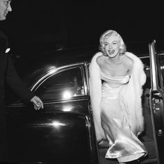 Marilyn Monroe: 1954: EXCLUSIVE American actor Marilyn Monroe (1926 - 1962) emerges from a car, wearing a strapless white gown and white fur coat at the premiere of director Walter Lang's film 'There's No Business Like Show Business'.