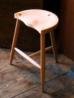 Custom sculpted wood stool by Paul Baines