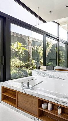 Beautiful windows surrounding the tub.
