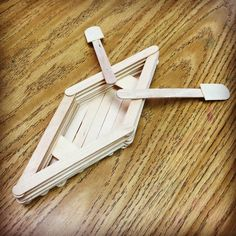 A simple canoe from regular and jumbo popsicle / craft sticks. #popsiclestick #craftstick #canoe