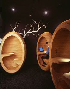 These cool looking laptop pods are little workspaces designed to bring together occupants of a 242 unit apartment development in Melbourne, Australia. The pods are placed in a communal area to draw people out of their homes and encourage a sense of community.