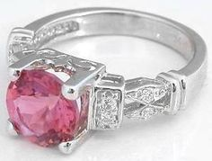 Pink tourmaline and diamond ring.  Think this would make a gorgeous right hand ring for me.  :)