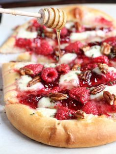 Raspberry Brie Pizza~ creamy brie cheese,raspberry jam and fresh raspberries, chopped rosemary, candied pecans and a drizzle of honey!This is my go to app. to make when hosting a party!