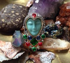 Beautiful moon goddess face, sterling silver ring. Featuring beautiful Blood Ruby and Emerald gemstones.