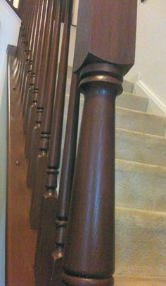 """Use Rust-Oleum Cabinet Transformations Dark Base Satin Cabinet Paint (tinted """"Rustic"""") to change builder grade Oak stair rails."""