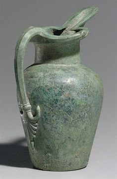 AN ETRUSCAN BRONZE OINOCHOE CIRCA EARLY 5TH CENTURY B.C.