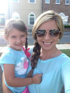 """Kelli is totally rocking the #Summer Side Braid with her Hidden Crown Hair Extensions! She wears a 16"""" in color #6! (Side note: don't her and her daughter look adorable together?) heart emoticon"""