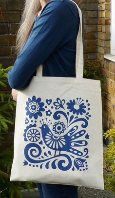 Tote Bag Book Bag Mexican Blue Bird Flowers Folk Art by Fran Wood Design. The bi… Tote Bag Book Tote Mexican Blue Bird Flower Folk Art by Fran Wood Design. The bird and flower were inspired by Frida Kahlo paintings and Mexican embroidery. Mexican Embroidery, Embroidery Bags, Folk Embroidery, Embroidery Designs, Flower Embroidery, Paper Cut Design, Fabric Design, Painted Bags, Printed Tote Bags