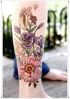 Coloured wildflowers tattoo on leg