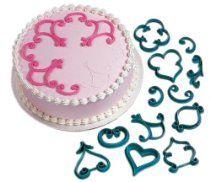 Wilton 2104-3160 12-Piece Cake-Decorating Press Set, Decorator Favorites From Wilton List Price:$9.99